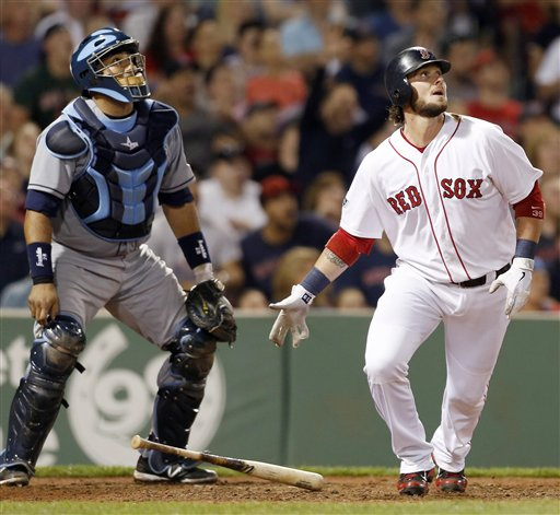 Boston Red Sox's Jarrod Saltalamacchia, right, watches his two-run home run to defeat the Tampa Bay Rays 3-2 in front of Rays catcher Jose Molina in the ninth inning of a baseball game in Boston, Saturday, May 26, 2012. (AP Photo/Michael Dwyer)
