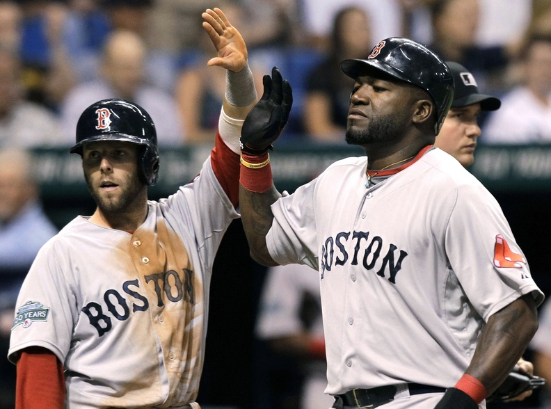 Boston's Dustin Pedroia and David Ortiz celebrate after scoring on an eighth-inning single by teammate Cody Ross off Tampa Bay Rays relief pitcher J.P. Howell on Thursday in St. Petersburg, Fla. The Red Sox won, 5-3.