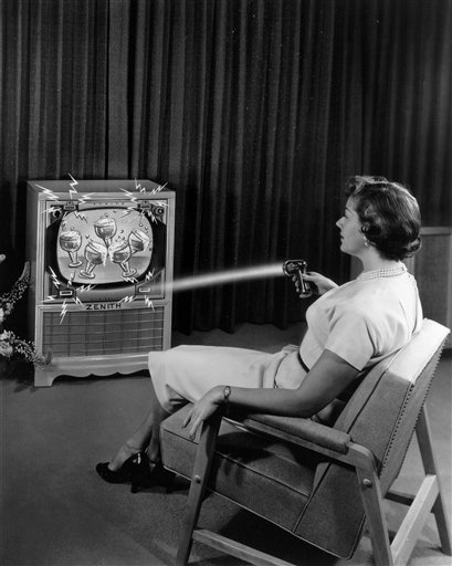"""This 1955 photo illustration provided by LG Electronics, shows an ad for a Zenith """"Flash-Matic,"""" the first wireless TV remote control. A spokesman for Zenith Electronics says engineer Eugene Polley, the inventor of the device, died May 20, 2012, of natural causes in Downers Grove, Ill. He was 96. Polley and fellow Zenith engineer Robert Adler were honored in 1997 with Emmys for their work in pioneering TV remotes. (AP Photo/LG Electronics)"""