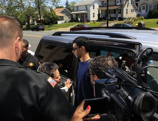 Dharun Ravi, 22, arrives at the Middlesex County sheriff's department in New Brunswick, N.J., today. The former Rutgers University student convicted of using a webcam to spy on his gay roommate reported to the sheriff on his way to jail. Ravi arrived at the sheriff's department shortly after 12:30 p.m. to be fingerprinted and photographed before being driven to the county jail to serve a 30-day term.