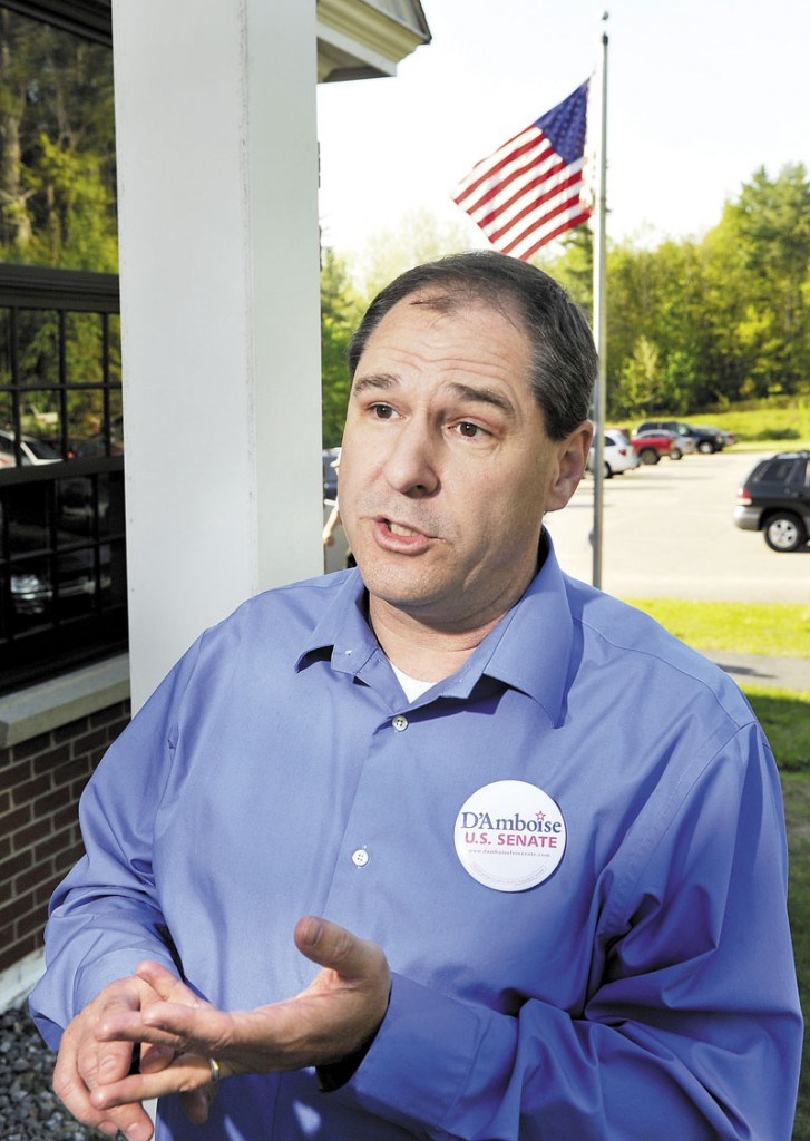 Senate candidate Scott D'Amboise campaigning at spaghetti supper in Lisbon on Saturday.