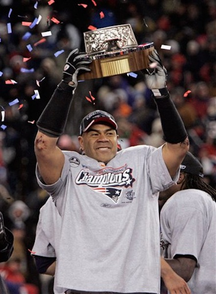In this Jan. 20, 2008, file photo, New England Patriots linebacker Junior Seau holds the Lamar Hunt Trophy looks on after defeating the San Diego Chargers 21-12 in the AFC Championship NFL football game in Foxborough, Mass. Police say Seau, a former NFL star, was found dead at his home in Oceanside, Calif., Wednesday, May 2, 2012, after responding to a shooting there. He was 43. (AP Photo/Winslow Townson, File) NFL