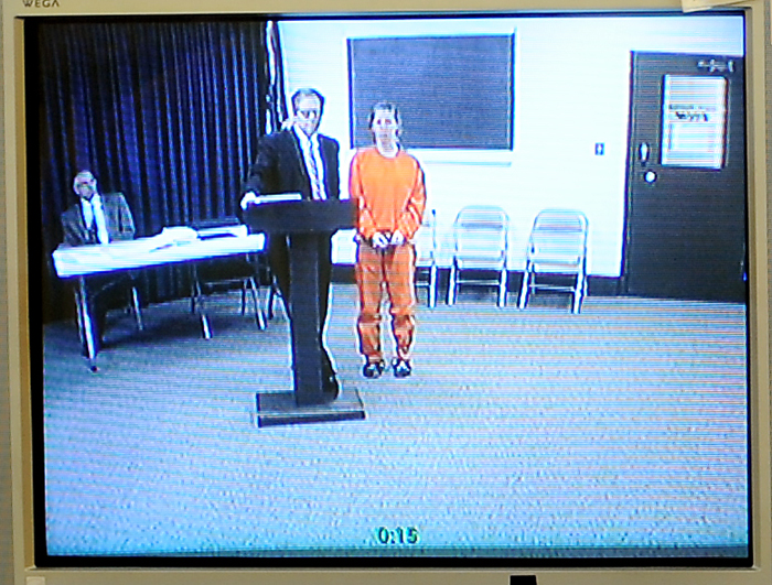 In this photo of a video screen in the office of Maine District Court Justice Donald Alexander, Kristina Lowe, 19, appears via video uplink from the Oxford County Jail in Paris. She faces two manslaughter charges in connection with a fatal car crash that happened while police say she was texting back and forth with friends at an underage drinking party.
