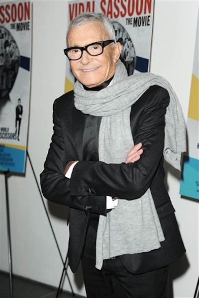 """In this Feb. 9, 2011 file photo released by Starpix, hair designer and businessman, Vidal Sassoon, stops for a photo at a special screening of """"Vidal Sassoon: The Movie,î in New York. Sassoon, whose 1960s wash-and-wear cuts freed women from endless teasing and hairspray died Wednesday, May 9, 2012, at his home. He was 84. (AP Photo/Starpix, Dave Allocca)"""