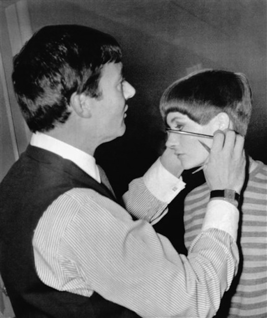 In this Jan. 11, 1966 file photo, hair stylist Vidal Sassoon gives New York model Holly McGuire a close-cropped hairdo at a preview of the New York Couture Group styles in New York. Sassoon, whose 1960s wash-and-wear cuts freed women from endless teasing and hairspray died Wednesday, May 9, 2012, at his home. He was 84. (AP Photo, file) Cutting Standing Expertise Holding Scissors Preparation
