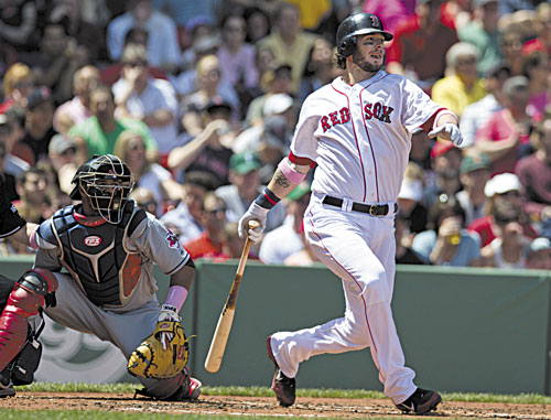 WATCH IT FLY: Boston's Jarrod Saltalamacchia watches his two-run single off Cleveland's Justin Masterson during the first inning Sunday at Fenway Park in Boston. Indians catcher Carlos Santana is at left. Saltalamacchia finished 3 for 4 with a home run and five RBIs.