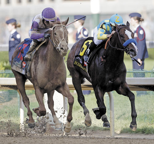 TO THE FINISH: Jockey Mario Gutierrez rides I'll Have Another, left, past Bodemeister, ridden by Mike Smith (6), to victory in the 138th Kentucky Derby on Saturday at Churchill Downs in Louisville, Ky.