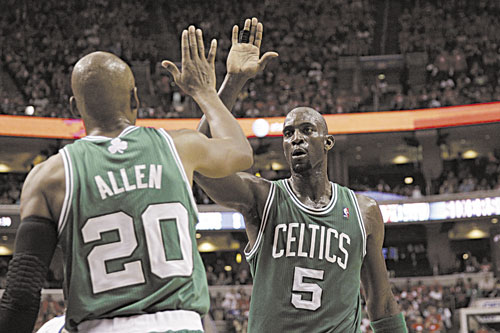 WAY TO GO: Boston's Kevin Garnett high-fives teammate Ray Allen during the first half of Game 3 of an NBA Eastern Conference semifinal playoff series against the Philadelphia 76ers on Wednesday in Philadelphia. Garnett, who turns 36 on Saturday, made 12 of 17 shots in Game 3 and is shooting 63 percent overall in the series.