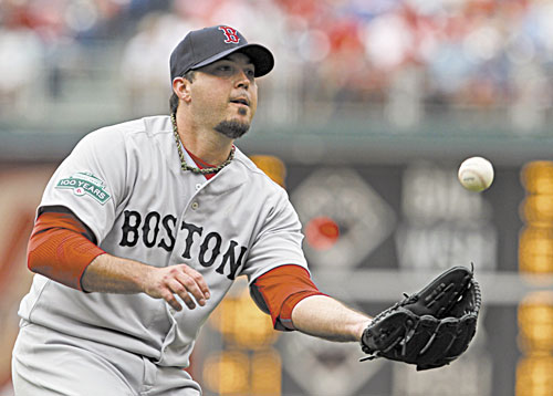 STAYING FOCUSED: Boston starting pitcher Josh Beckett fields a ball hit by Philadelphia's Ty Wigginton during the seventh inning of an interleague game Sunday in Philadelphia. Beckett allowed one run on seven hits while striking out five and walking two in 72⁄3 innings.