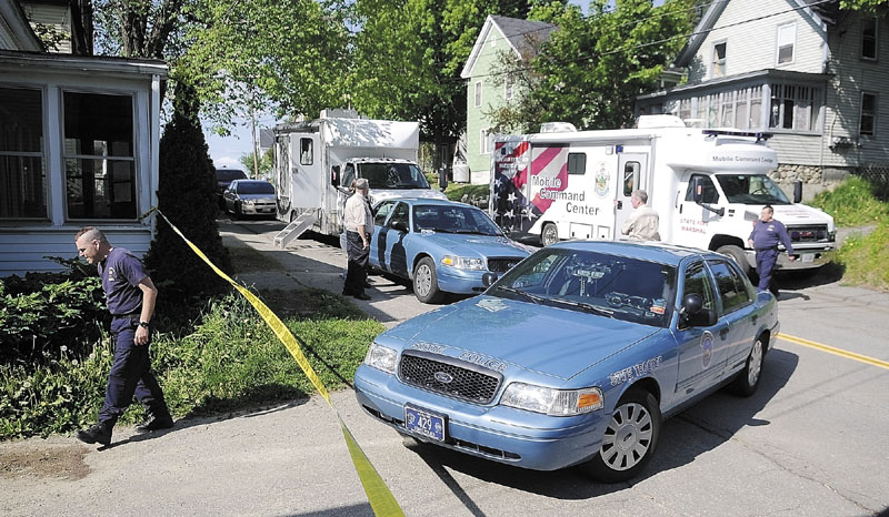 Police vehicles block Gage Street in Augusta on Thursday afternoon while authorities investigate explosives found in an apartment.