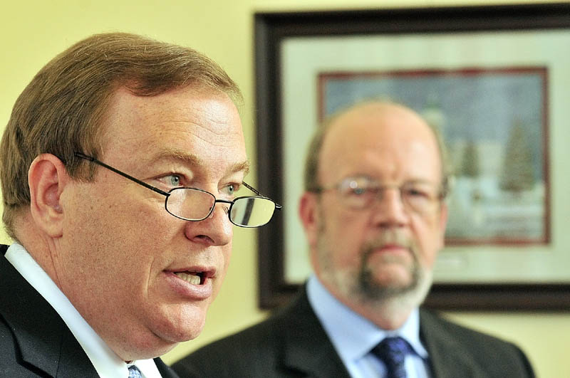 Senate President Kevin Raye, R-Perry, left, and Speaker of the House Robert Nutting, R-Oakland, discuss a plan to close a budget gap Thursday in the State House in Augusta.