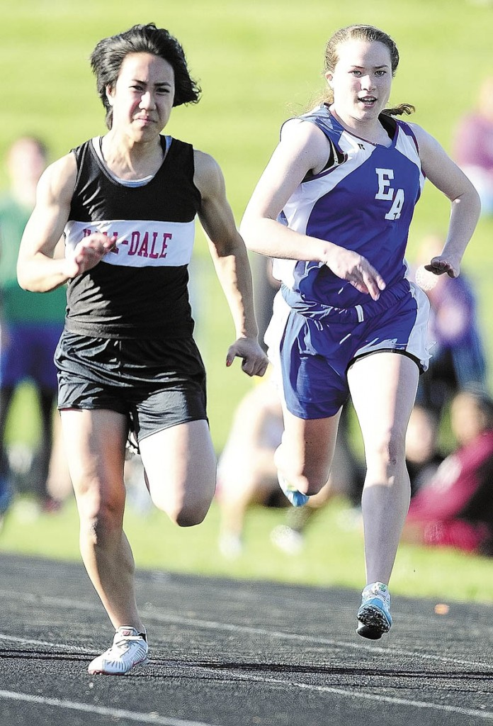 TRIFECTA: Hall-Dale's Bri Crisci, left, leads Erskine Academy's Jade Canak in 100 meter dash during the Capital City Classic last week at Alumni Field in Augusta. Crisci won in 12.83, her fastest time of the season. She also won the 200 and the 400.