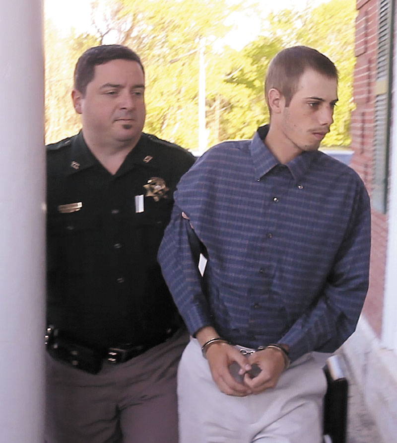 Gordon Collins-Faunce is led into York County Superior Court in Alfred on Friday. Collins-Faunce was charged with depraved indifference murder and is being held on $100,000 bail.