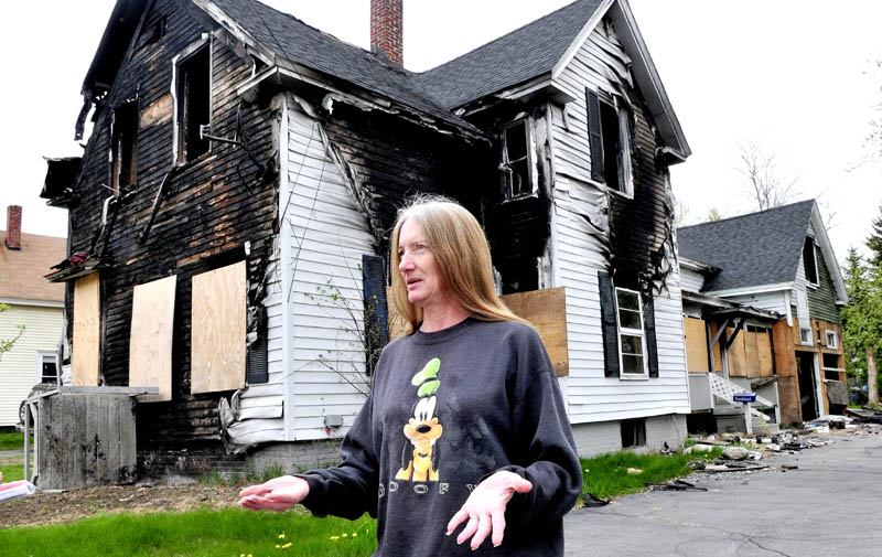 NEIGHBORHOOD CONCERN: Diana Foster speaks about her desire to have a neighbor's home demolished on Oak Street in Waterville. The home was destroyed and has been vacant since last year.