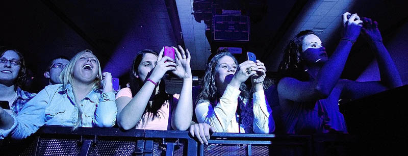 Front row fans snap pictures of country star Dierks Bentley as he performs Thursday night at the Augusta Civic.