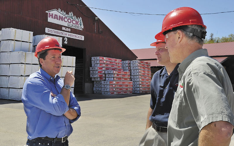Heading east: Hancock Lumber President Kevin Hancock, left, chats with Matt Duprey, VP Sales and Kevin Hynes, Chief Operating Officer, right, who are going to Japan for a business trip to enhance their overseas exports.