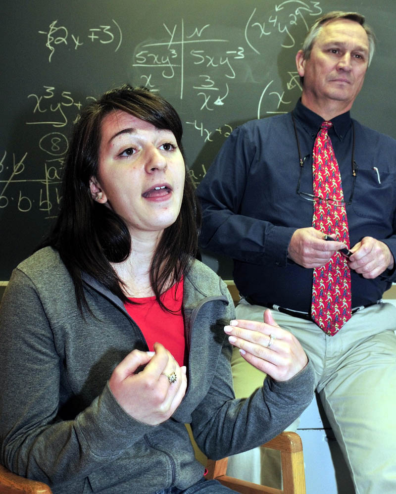 HEAD OF THE CLASS: Madison Area Memorial High School student Kristin Bishop speaks about being selected to serve as a student representative on the Maine State Board of Education. School Principal Stephan Ouellette is behind her.