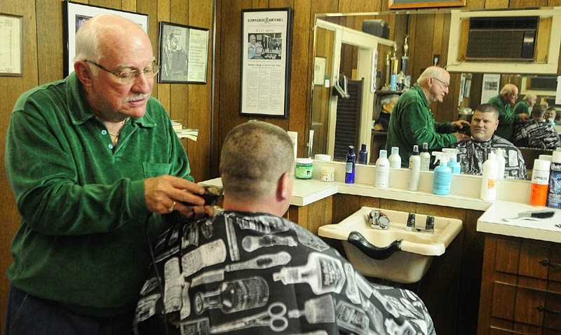 Francis Lorette cuts Dana Blackstone's hair on Tuesday afternoon at Lorette's Barber Shop in Winthrop. Blackstone said that Lorrete had given him his first childhood haircut too. Lorette closed his 49-year-old business last Saturday, but did two last haircuts on Tuesday afternoon before packing up his clippers.