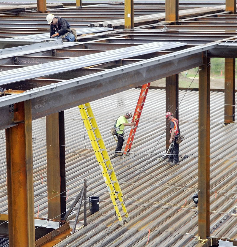 Construction workers are seen climbing among the girders during a recent tour of MaineGeneral's new regional hospital under construction in North Augusta.