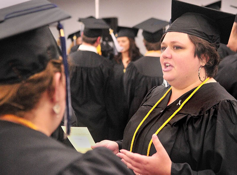 Elizabeth Franck, left, and Tessa Pyles chat before University of Maine at Augusta graduation exercises on Saturday morning in the Augusta Civic Center.