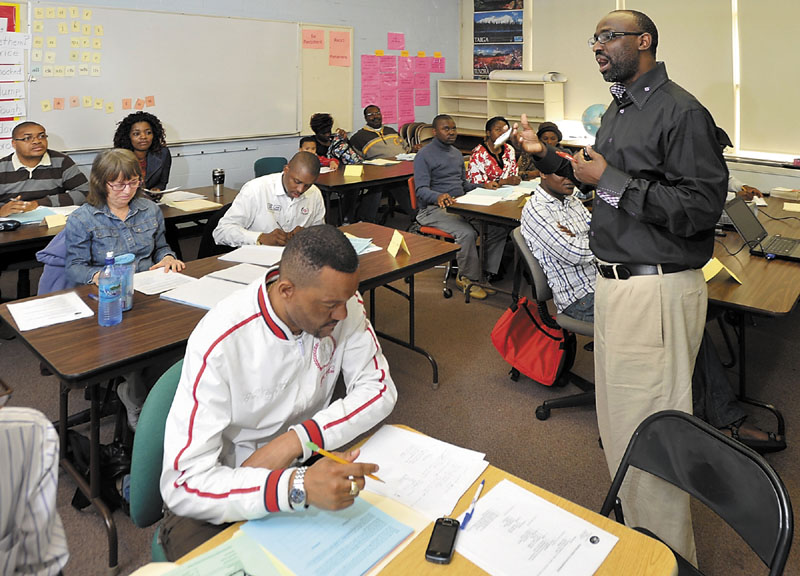 """Instructor Claude Rwaganje teaches a class on responsible finance management at the Portland Adult Education Center that includes immigrants, low-income and """"unbanked"""" residents."""