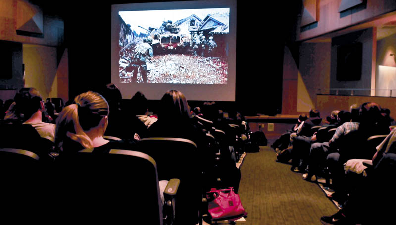 Mount View High School students watch a slide show presentation of images taken during the Vietnam War during a presentation by veteran Vince Gabriele at the Thorndike school on Wednesday.