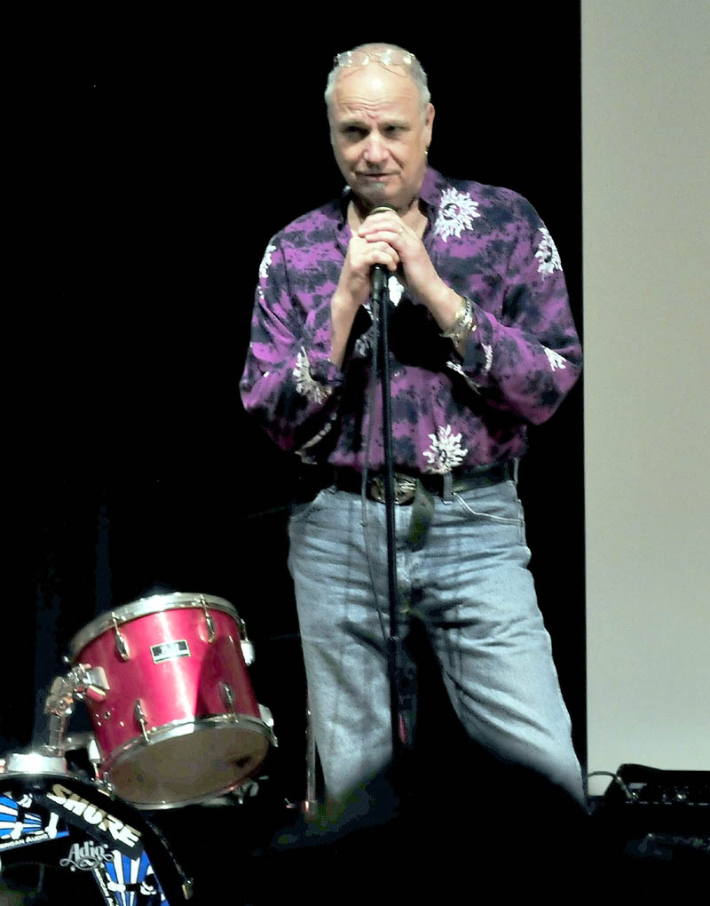Vince Gabriel, Vietnam veteran, storyteller, and musician on Wednesday discusses his experinece during war time in a multimedia format to students at Mount View High School in Thorndike.