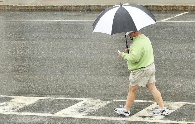 A walker with an umbrella walks through Market Square on a rainy Tuesday afternoon in downtown Augusta. It would be a good idea to those umbrellas handy, since, the National Weather Service forecast calls for rain through Thursday evening.