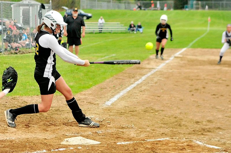 BIG HIT: Maranacook's Sarah Boynton hits a home run that scored teammate Jessie Smith from third base during the Black Bears' 5-1 win on Wednesday in Readfield.