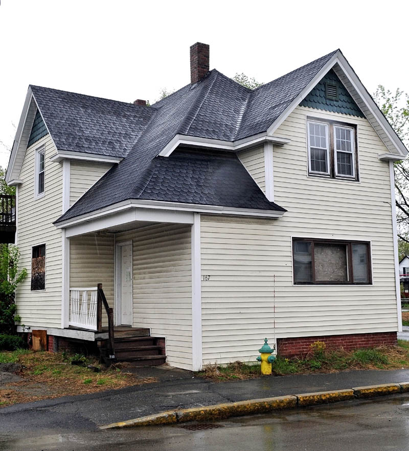 UP FOR GRABS: The city of Waterville is deciding the value and future use of this home at 167 Water St. that was taken for unpaid taxes.