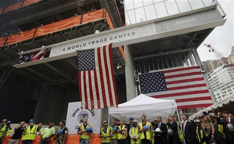 Construction workers and officials watch as the ceremonial last beam is hoisted to the top of Four World Trade Center, Monday, June 25, 2012. The 72-floor, 977-foot tower is scheduled to open late next year. It's expected to be the first tower completed on the 16-acre site since the 9/11 attacks. (AP Photo/Mark Lennihan) Silverstein;9/11;Sept 11;ground zero