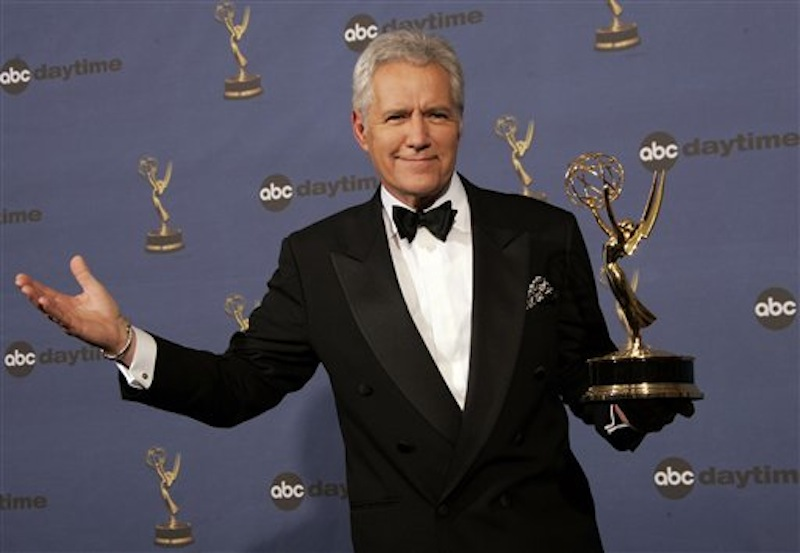 "In this Friday, April 28, 2006, file photo, Alex Trebek holds the award for outstanding game show host, for his work on ""Jeopardy!"" backstage at the 33rd Annual Daytime Emmy Awards in Los Angeles. Sony Television spokeswoman Paula Askanas said Sunday, June 24, 2012, that Trebek is in a Los Angeles hospital recovering from a mild heart attack. (AP Photo/Reed Saxon, File)"