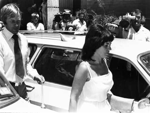 In this Feb. 2, 1982, photo, Michael, left, and Lindy Chamberlain leave a courthouse in Alice Springs, Australia. A coroner found today that a dingo took the Chamberlains' baby who vanished in the Australian Outback more than 32 years ago in a notorious case that split the nation over suspicions that the infant was murdered.