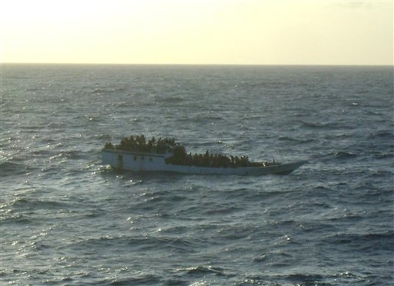 This June 27, 2012 photo released by Australian Maritime Safety Authority shows a boat carrying asylum seekers 200 kilometers (120 miles) north of Christmas Island in the Indian Ocean hours before capsizing Wednesday, June 27, 2012. The boat capsized Wednesday and 123 people were rescued from the ocean, Prime Minister Julia Gillard said, less than a week after more than 90 people drowned on a similar journey. (AP Photo/Australian Maritime Safety Authority)