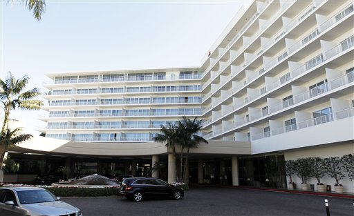 Police say two people have been found dead in what investigators believe was a murder-suicide in a room at the Beverly Hilton. The luxury hotel was also the site of Whitney Houston's death in February.