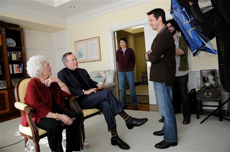 This image released by HBO shows former first lady Barbara Bush, from left, former President George H. W. Bush, Kris Conde, Stephen Glidden, Jeffrey Roth during the filming of