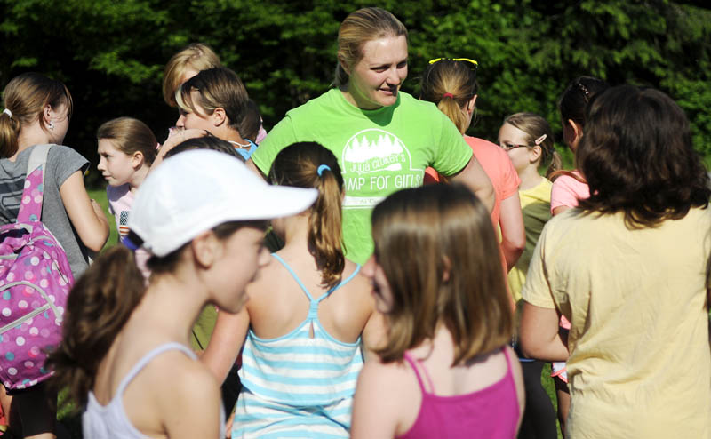 HAPPY CAMPERS: U.S. Olympic luger and Augusta native Julia Clukey, center, chats with campers Wednesday as they arrive for the first day of the Camp for Girls in Readfield. Operated in conjunction with Kennebec Valley YMCA, Julia Clukey's Camp for Girls welcomed 94 girls between the ages of 8-11 for a week of outside activities and development.