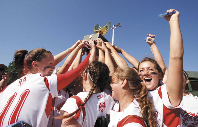 Gregory Rec/Staff Photographer: Cony players hoist the championship trophy and celebrate their perfect season with a win over South Portland in the Class A softball championship at St. Joseph's College in Standish on Saturday, June 16, 2012. Cony had a 22-0 season with their 2-0 win over the Red Riots on Saturday.