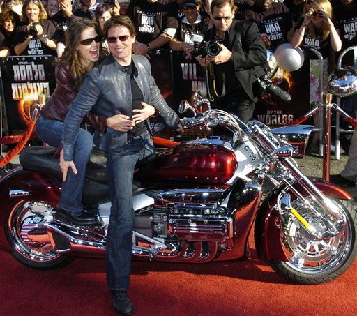"In this June 27, 2005, photo, Tom Cruise arrives with his then-fiancee Katie Holmes on a motorcycle for a screening of ""War of the Worlds,"" in which Cruise starred."