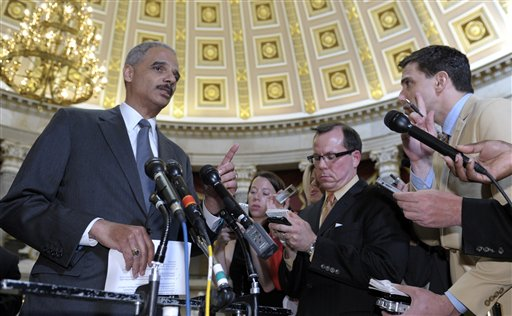 Attorney General Eric Holder speaks to reporters following a meeting on Capitol Hill on Tuesday. A House committee's chairman wants more Justice Department documents regarding Operation Fast and Furious, a flawed gun-smuggling probe in Arizona. The House committee voted Wednesday to hold Holder in contempt for failing to turn over the documents.