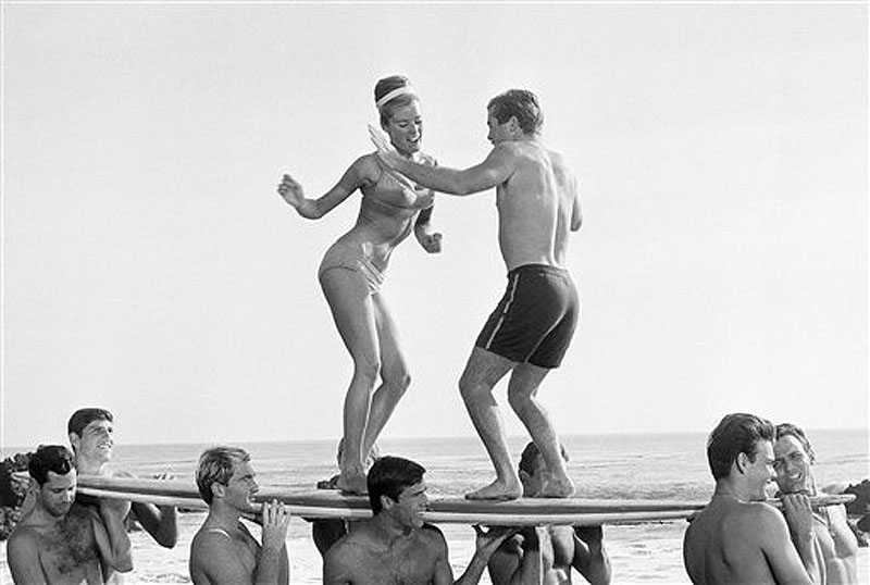"In this January 5, 1965, file photo, actors in a Hollywood movie dance ""the twist"" in Malibu, Calif. The Federal Reserve announced Wednesday, June 20, 2012, it is extending its ""Operation Twist"" program, which is named after the dance craze in an a nod to economic history when the Kennedy administration cut long-term rates while leavings short-term rates alone in the early 1960s. The program is designed to spur borrowing and spending. (AP Photo/File) ""1960s lifestyle"";""beach movie"";bathing;suits;Beach;Dance;Entert"