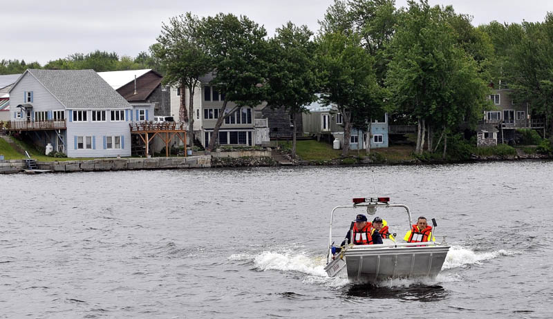 ON THE LOOKOUT: Maine Warden Service officials search China Lake for missing swimmer Tye Feihel on Tuesday.