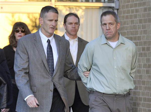 Frederick Osbon, right, is escorted by FBI agents as he is released from The Pavilion at Northwest Texas Hospital in Amarillo, Tex. in this April, 2, 2012, photo.