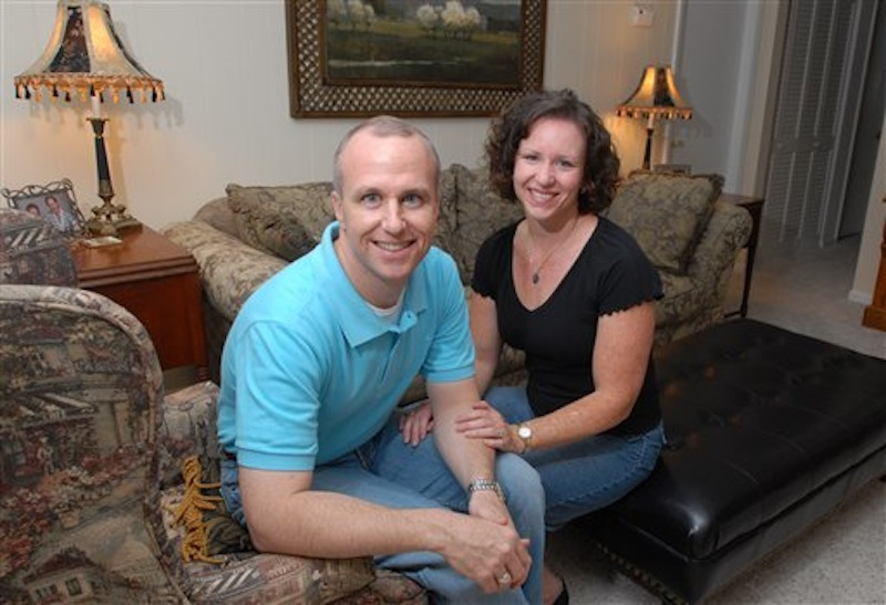 """In this Thursday, May 11, 2006 file photo, Alan Chambers, left, president of Exodus International, sits with his wife, Leslie, in their home in Winter Park, Fla. The president of the country's best-known Christian ministry dedicated to helping people repress same-sex attraction through prayer is trying to distance the group from the idea that gay people's sexual orientation can be permanently changed or """"cured."""" Chambers said Tuesday, June 26, 2012 that their upcoming national conference would highlight his efforts to dissociate the group from the controversial practice usually called ex-gay, reparative or conversion therapy. (AP Photo/Phelan M. Ebenhack)"""