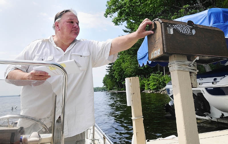 Norm Shaw has been delivering the mail from his boat on Great Pond in Belgrade and Rome for nine years.