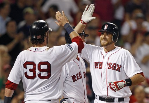 Boston Red Sox Will Middlebrooks, right, is congratulated by Jarrod Saltalamacchia (39) after his two-run home run against the Miami Marlins during the eighth inning of a baseball game at Fenway Park in Boston, Thursday, June 21, 2012. (AP Photo/Charles Krupa)