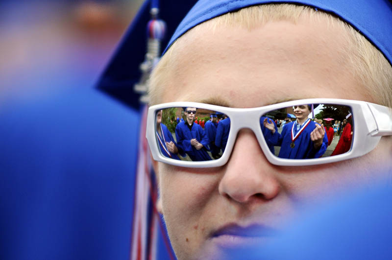 MOVING ON: Messalonskee High School senior Luke Principato, of Oakland, waits with classmates Thursday for graduation in Augusta to begin.