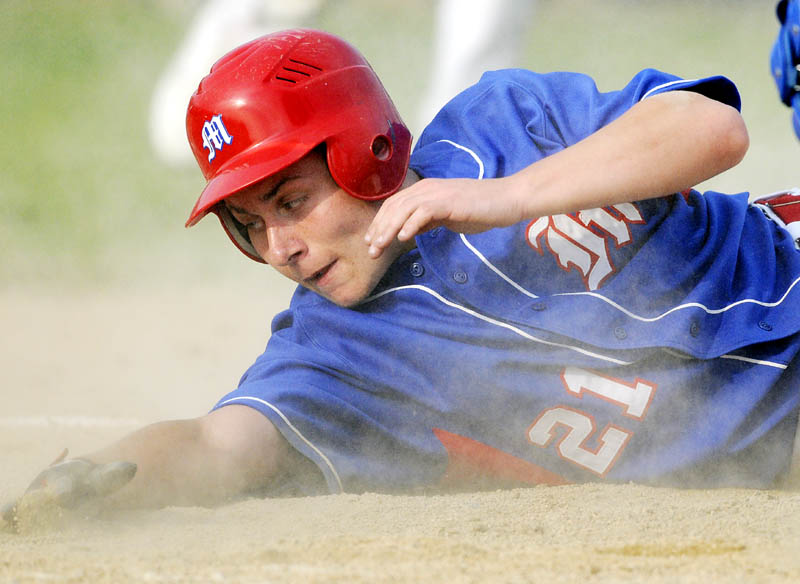 COMING HOME AGAIN: Messalonskee High School's Reid Nutter slides safely into home plate during the Eagles' 13-2 win over Lewiston in the Eastern Maine Class A championship game Tuesday at Morton Field in Augusta.