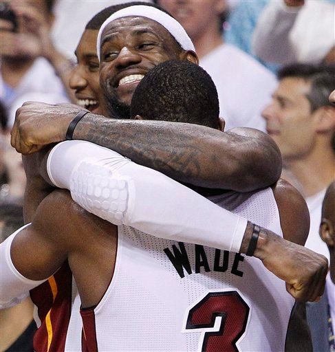 Miami Heat small forward LeBron James (6) and shooting guard Dwyane Wade react in the final moments during the second half at Game 5 of the NBA finals basketball series against the Oklahoma City Thunder, Thursday, June 21, 2012, in Miami. The Heat won 121-106 to become the 2012 NBA Champions. (AP Photo/Lynne Sladky)