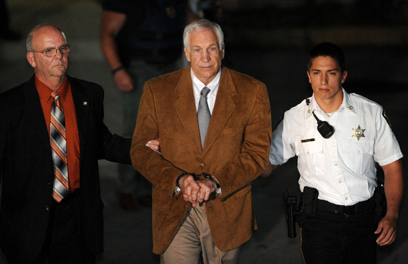 Jerry Sandusky leaves the Centre County Courthouse Friday after being found guilty in his sexual abuse trial, in Bellefonte, Pa. Sandusky was convicted of sexually assaulting 10 boys over 15 years Friday, accusations that had sent shock waves through the college campus known as Happy Valley and led to the firing of Penn State's beloved Hall of Fame coach, Joe Paterno. (